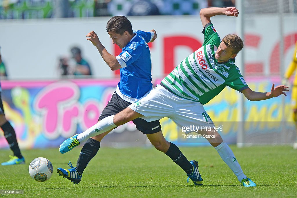 Tim Jerat (L) of Bielefeld and Tom Weilandt of Fuerth fight for the ball during the Second Bundesliga match between Greuther Fuerth and Arminia Bielefeld at the Trolli Arena on July 21, 2013 in Fuerth, Germany.