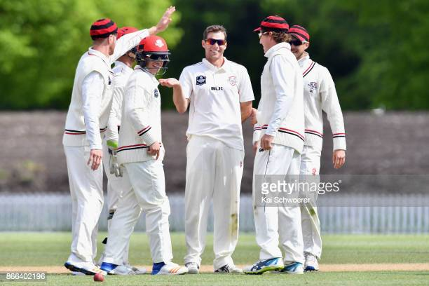 Tim Johnston of Canterbury is congratulated by team mates after dismissing Neil Broom of Otago for 48 runs during the Plunket Shield match between...