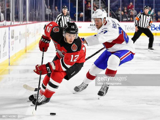 Tim Kennedy of the Binghamton Devils skates the puck against Peter Holland of the Laval Rocket during the AHL game at Place Bell on October 13 2017...