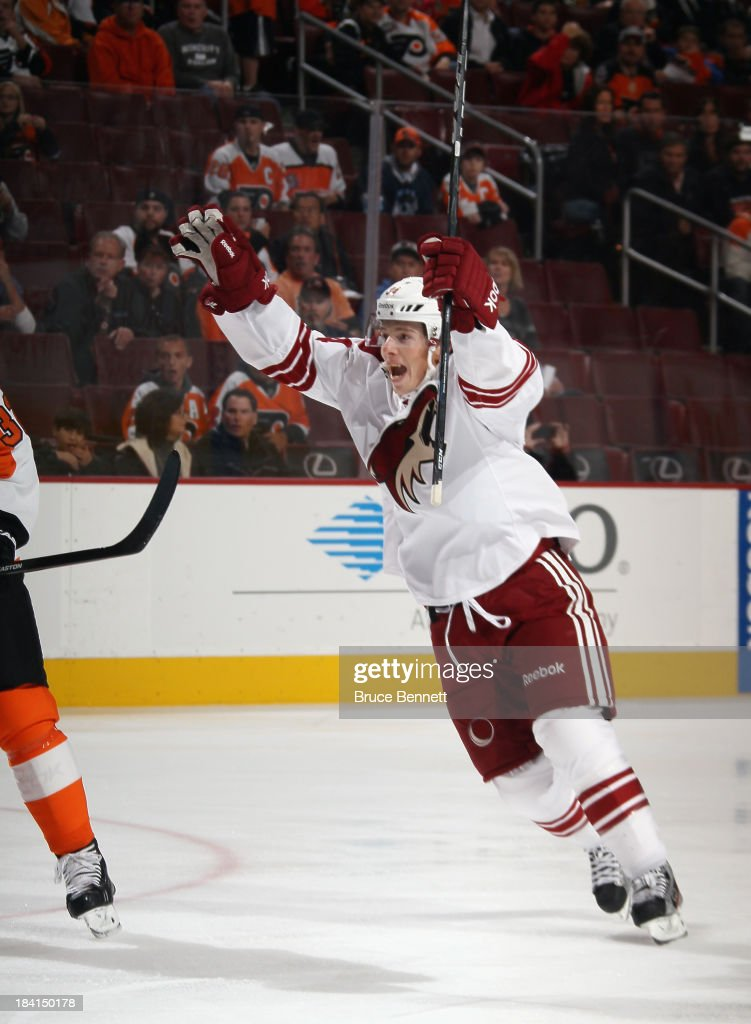 Tim Kennedy #34 of the Phoenix Coyotes celebrates a goal by Rob Klinkhammer #36 (not shown) during the first period against the Philadelphia Flyers at the Wells Fargo Center on October 11, 2013 in Philadelphia, Pennsylvania.