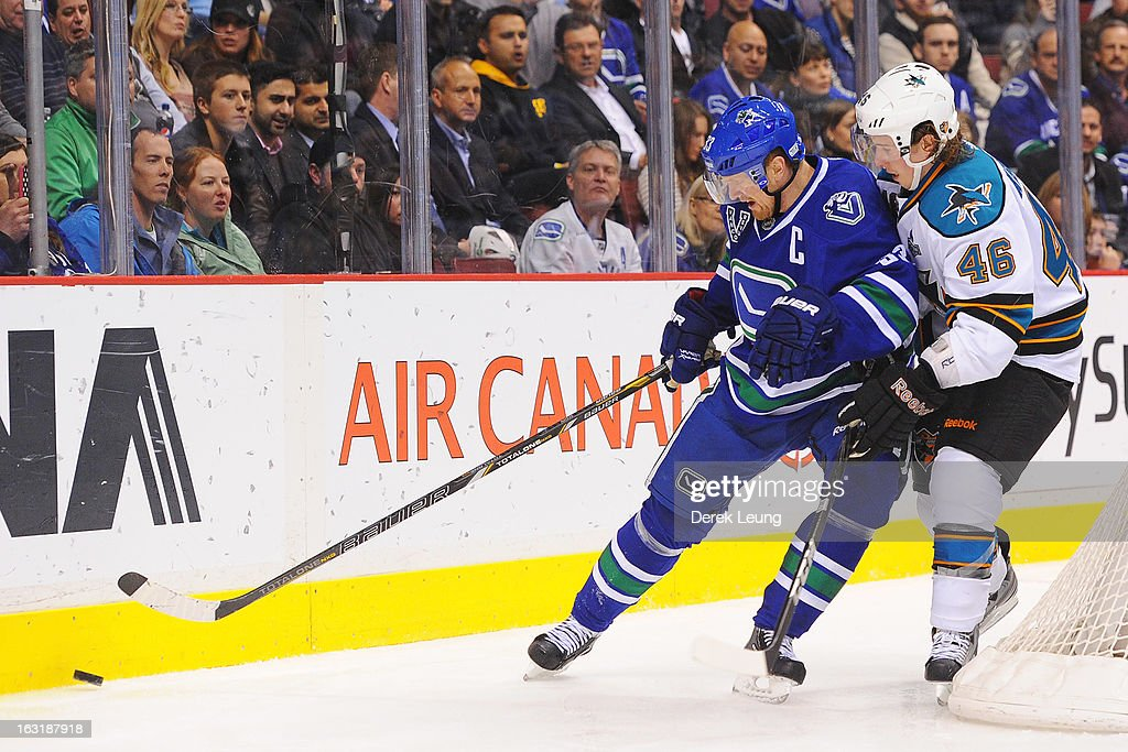 Tim Kennedy #46 of the San Jose Sharks checks <a gi-track='captionPersonalityLinkClicked' href=/galleries/search?phrase=Henrik+Sedin&family=editorial&specificpeople=202574 ng-click='$event.stopPropagation()'>Henrik Sedin</a> #33 of the Vancouver Canucks during an NHL game at Rogers Arena on March 5, 2013 in Vancouver, British Columbia, Canada.
