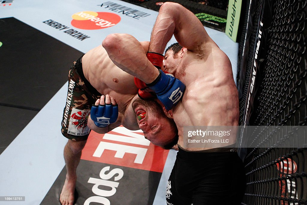 Tim Kennedy secures a guillotine choke submission against Trevor Smith in their middleweight bout during the Strikeforce event on January 12, 2013 at Chesapeake Energy Arena in Oklahoma City, Oklahoma.