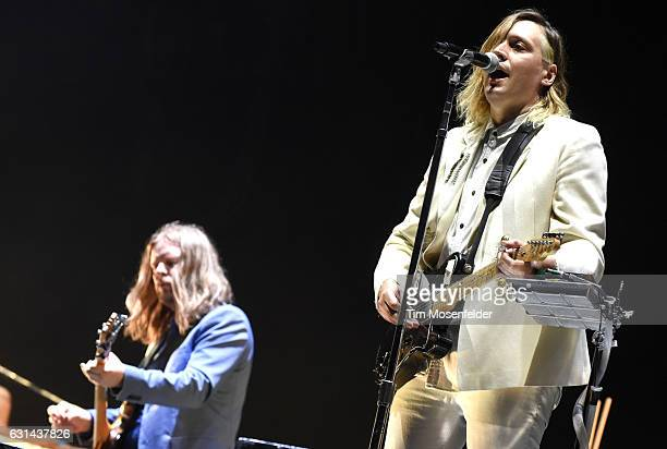 Tim Kingsbury and Win Butler of Arcade Fire perform during the Voodoo Music Arts Experience at City Park on October 30 2016 in New Orleans Louisiana