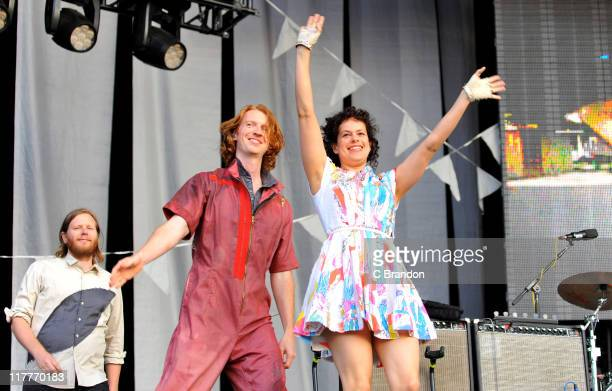 Tim Kingsbury Richard Parry and Regine Chassagne of Arcade Fire perform on stage at Hyde Park on June 30 2011 in London United Kingdom