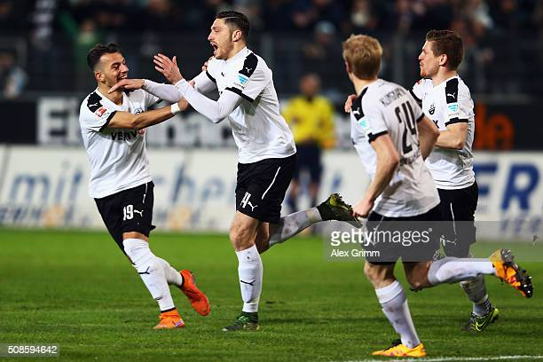 Tim Kister of Sandhausen celebrates his team's first goal with team mate Leart Paqarada during the Second Bundesliga match between SV Sandhausen and...