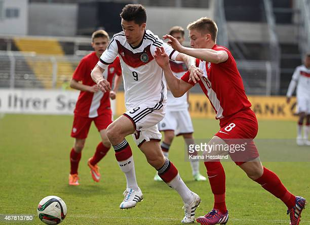 Tim Kleindienst of Germany is challenged by Radoslaw Murawski of Poland during the International Friendly match between U20 Germany and U20 Poland at...