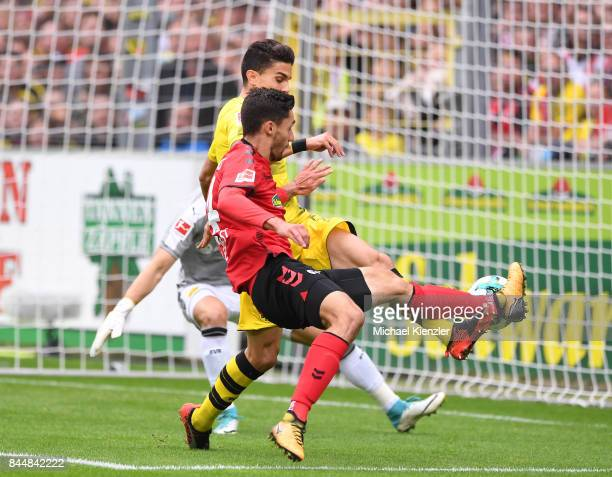 Tim Kleindienst of SC Freiburg with good chance for goal against Marc Aregall Bartra of Borussia Dortmund before the Bundesliga match between Sport...