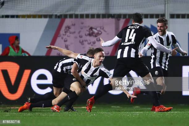 Tim Knipping of Sandhausen celebrates his team's first goal with team mates during the Second Bundesliga match between SV Sandhausen and 1 FC...