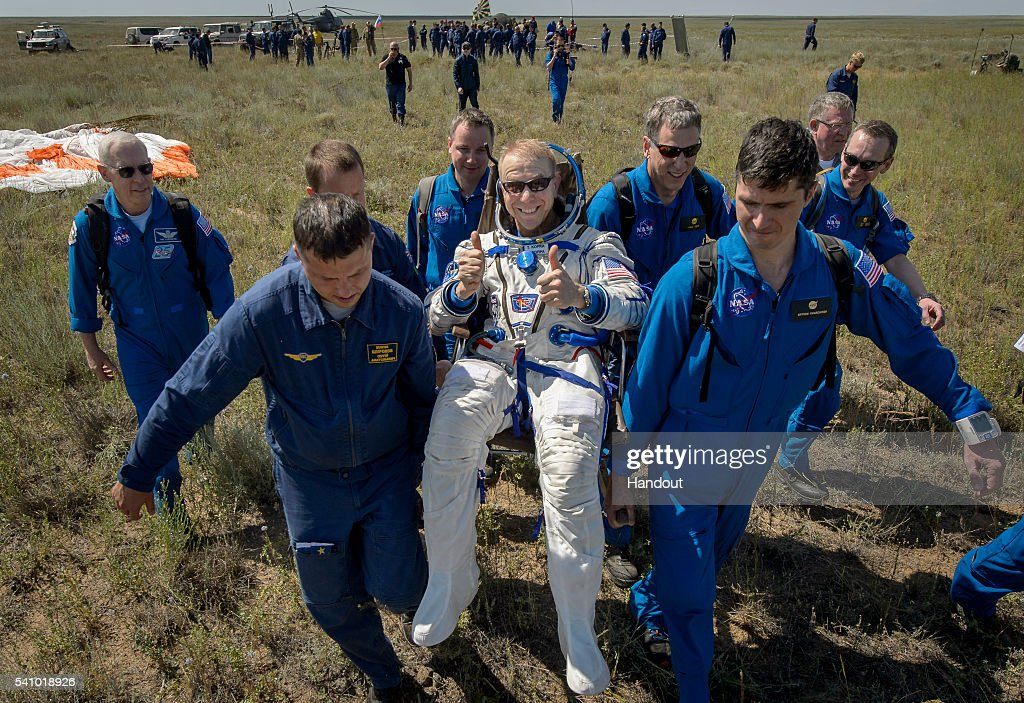 Tim Kopra of NASA is carried to a medical tent after he and <a gi-track='captionPersonalityLinkClicked' href=/galleries/search?phrase=Yuri+Malenchenko&family=editorial&specificpeople=198749 ng-click='$event.stopPropagation()'>Yuri Malenchenko</a> of Roscosmos and Tim Peake of the European Space Agency landed in their Soyuz TMA-19M spacecraft in a remote area on June 18, 2016 near the town of Zhezkazgan, Kazakhstan. Kopra, Peake, and Malenchenko are returning after six months in space where they served as members of the Expedition 46 and 47 crews onboard the International Space Station.