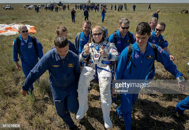 Tim Kopra of NASA is carried to a medical tent after he and Yuri Malenchenko of Roscosmos and Tim Peake of the European Space Agency landed in their...