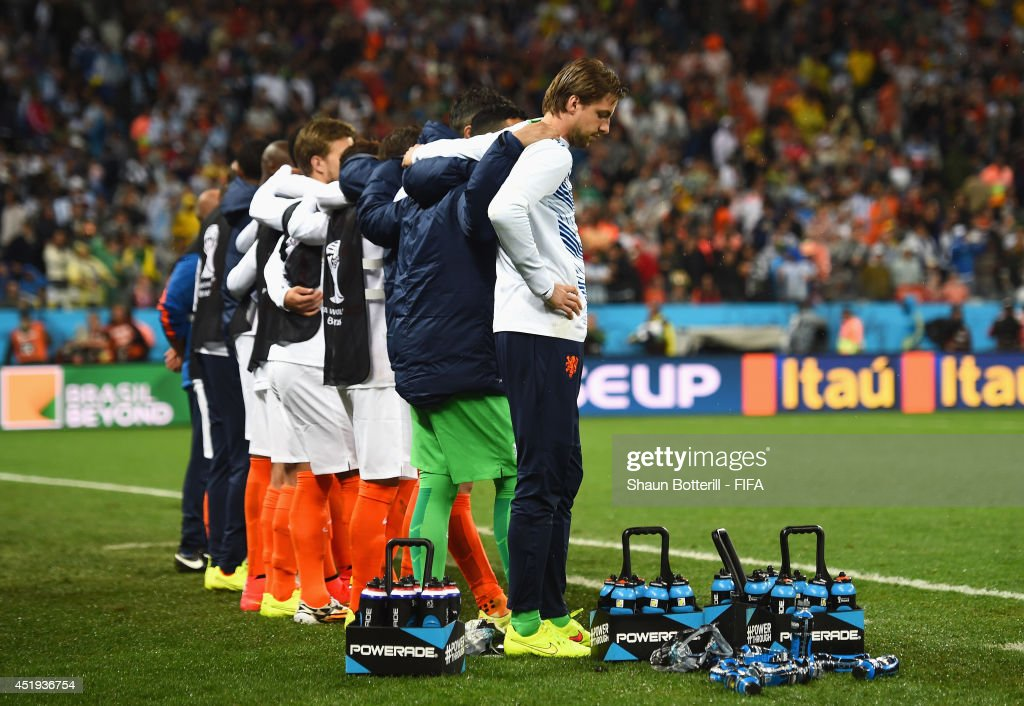 Tim Krul (1st R) and players of the Netherlands watch the penalty shootout during the 2014 FIFA World Cup Brazil Semi Final match between Netherlands and Argentina at Arena de Sao Paulo on July 9, 2014 in Sao Paulo, Brazil.