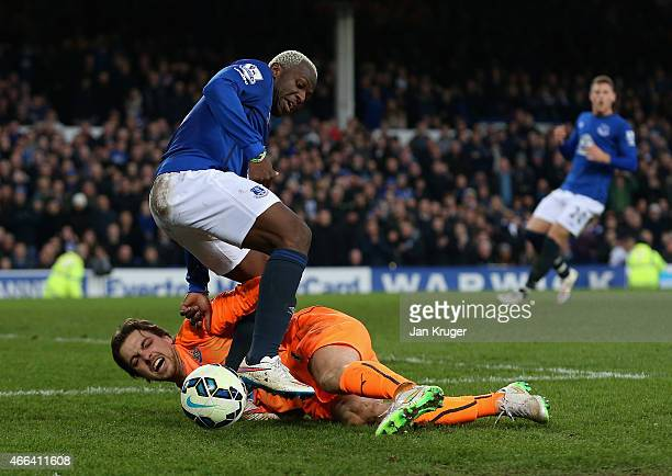 Tim Krul of Newcastle United challenges Arouna Kone of Everton during the Barclays Premier League match between Everton and Newcastle United at...