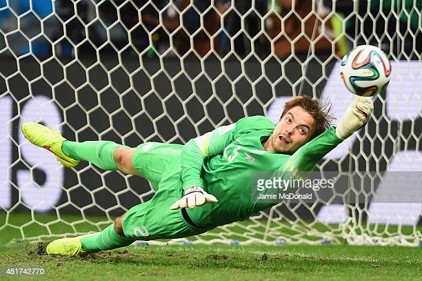Tim Krul of the Netherlands saves a penalty kick by Michael Umana of Costa Rica to win in a shootout during the 2014 FIFA World Cup Brazil Quarter...