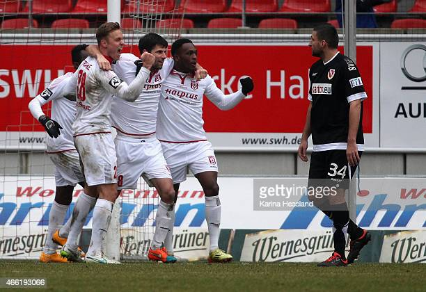 Tim Kruse of Halle celebrates the third with teammates during the Third League match between Hallescher FC and FC Energie Cottbus at ErdgasSportpark...
