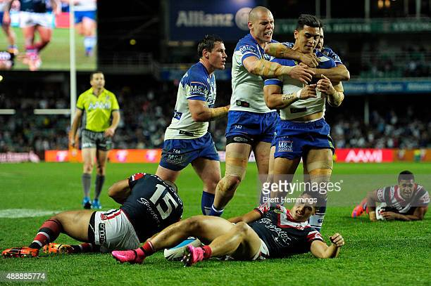 Tim Lafai of the Bulldogs celebrates scoring a try with team mates during the First NRL Semi Final match between the Sydney Roosters and the...
