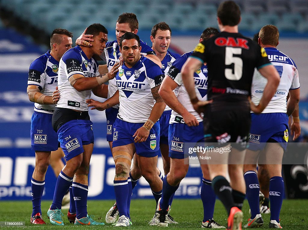 Tim Lafai of the Bulldogs is congratulated after scoring during the round 25 NRL match between the Canterbury Bulldogs and the Penrith Panthers at ANZ Stadium on August 31, 2013 in Sydney, Australia.