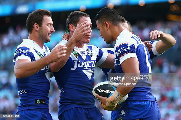 Tim Lafai of the Bulldogs is congratulated by team mates after scoring a try during the round nine NRL match between the St George Illawarra Dragons...