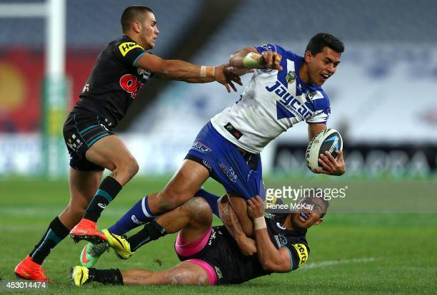 Tim Lafai of the Bulldogs is tackled by Dean Whare of the Panthers during the round 21 NRL match between the Canterbury Bulldogs and the Penrith...