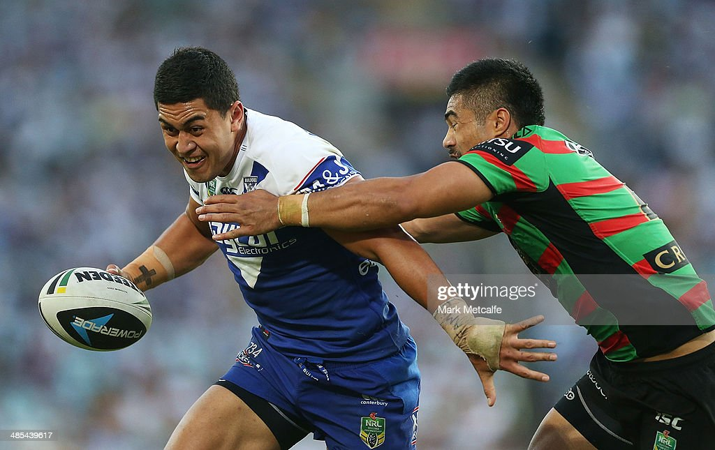 Tim Lafai of the Bulldogs is tackled by kirisome Auva'a of the Rabbitohs during the round seven NRL match between the South Sydney Rabbitohs and the Canterbury-Bankstown Bulldogs at ANZ Stadium on April 18, 2014 in Sydney, Australia.