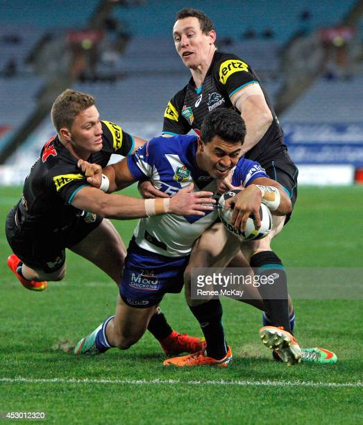Tim Lafai of the Bulldogs loses the ball as he is tackled by Matt Moylan during the round 21 NRL match between the Canterbury Bulldogs and the...
