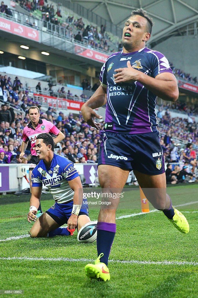 Tim Lafai of the Bulldogs reacts after scoring a try next to Will Chambers of the Storm during the NRL 2nd Elimination Final match between the Melbourne Storm and the Canterbury Bankstown Bulldogs at AAMI Park on September 14, 2014 in Melbourne, Australia.