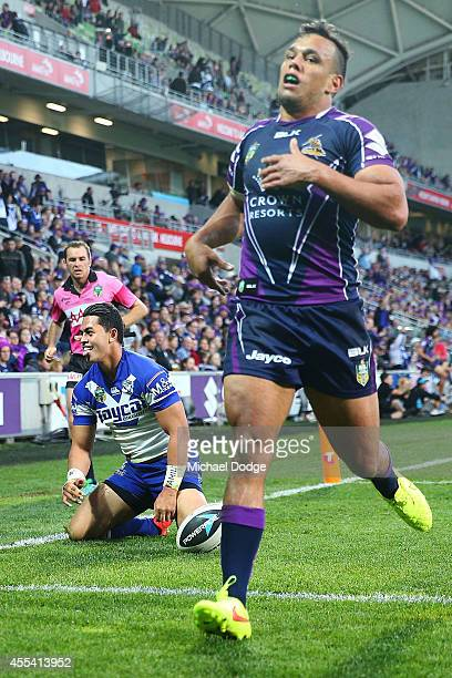 Tim Lafai of the Bulldogs reacts after scoring a try next to Will Chambers of the Storm during the NRL 2nd Elimination Final match between the...