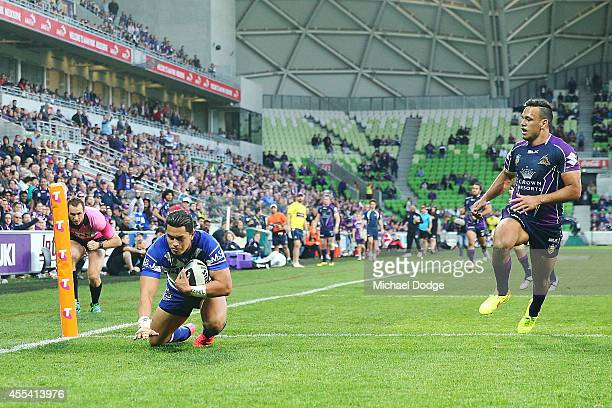 Tim Lafai of the Bulldogs scores a try next to Will Chambers of the Storm during the NRL 2nd Elimination Final match between the Melbourne Storm and...