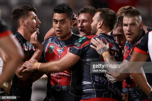 Tim Lafai of the Dragons celebrates with his team mates after scoring a try during the round four NRL match between the St George Illawarra Dragons...