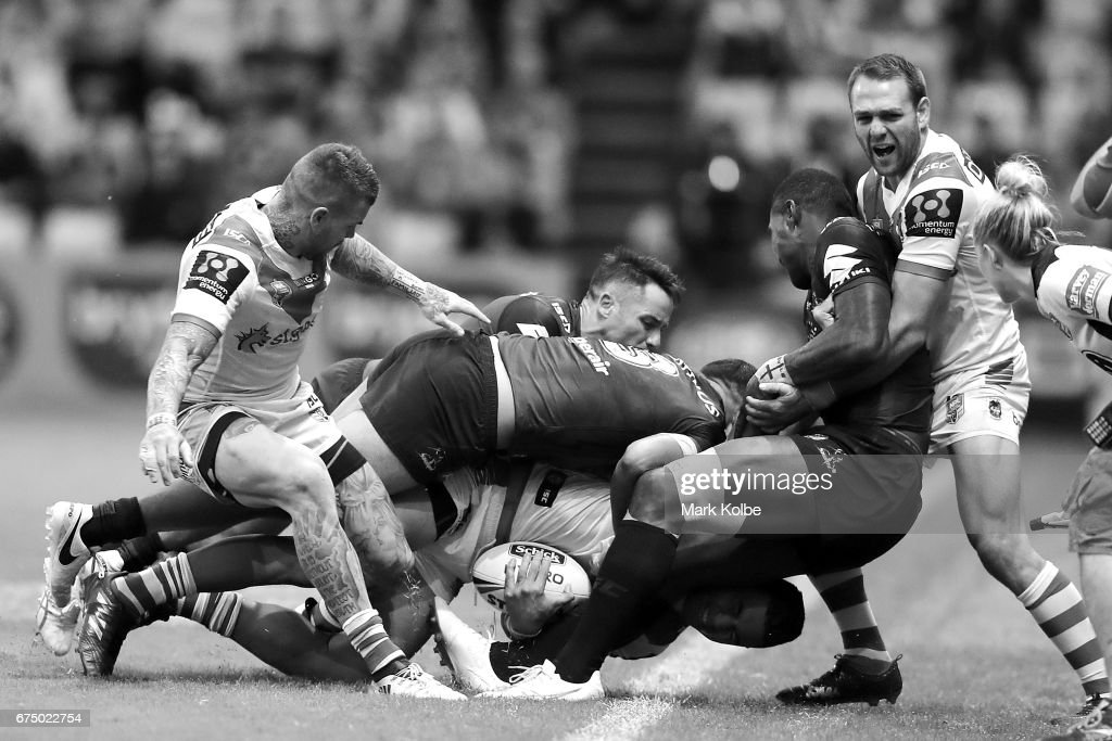 Tim Lafai of the Dragons is tackled into touch by Cooper Cronk, Will Chambers and Suliasi Vunivalu as Josh Dugan (L) and Jason Nightingale (R) failed to stop them during the round nine NRL match between the St George Illawarra Dragons and the Melbourne Storm at WIN Stadium on April 30, 2017 in Wollongong, Australia.