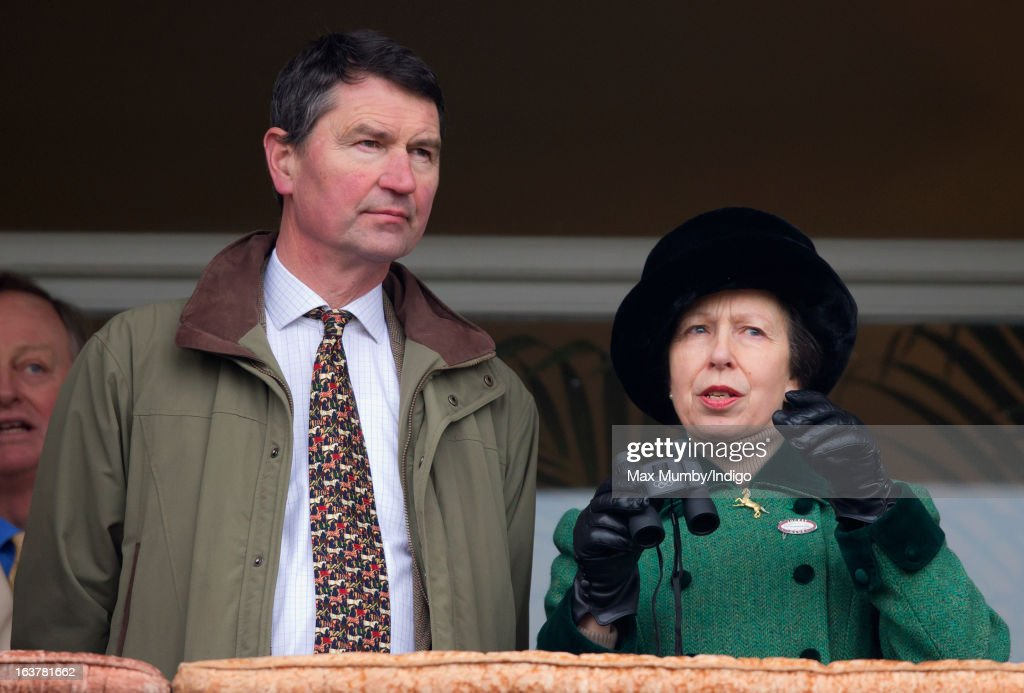 Tim Laurence and Princess Anne, The Princess Royal watch the racing as they attend Day 4 of The Cheltenham Festival at Cheltenham Racecourse on March 15, 2013 in London, England.