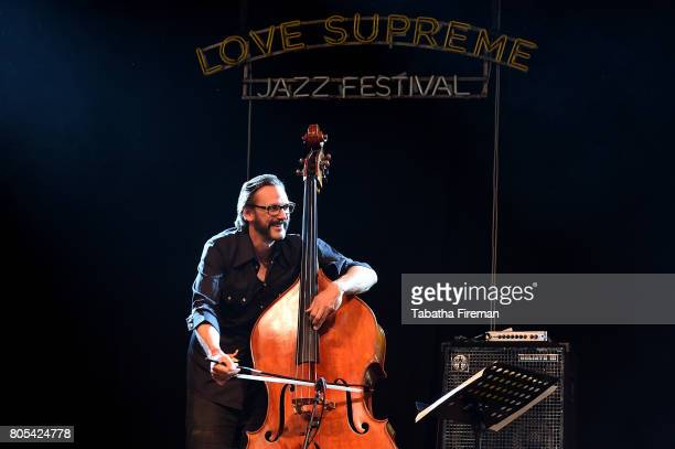 Tim Lefebvre of Michael Wollny Trio performs on the Big Top stage on Day 2 of Love Supreme Jazz Festival at Glynde Place on July 1 2017 in Lewes...