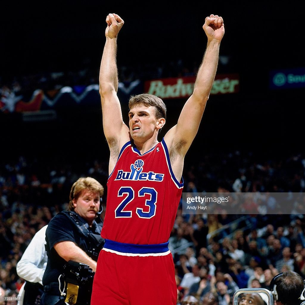Tim Legler of the Washington Bullets celebrates with his hands in the air during the 1996 ATT Three Point Shootout on February 10 1996 at the...