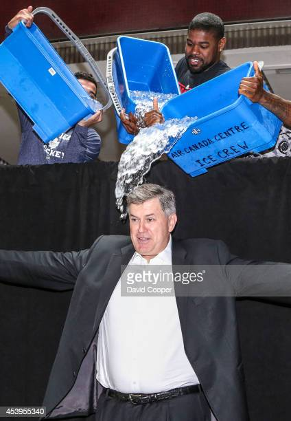 TORONTO ON AUGUST 20 Tim Leiweke spreads his arms just before MLSE stars Nazem Kadri Amir Johnson and Jermain Defoe dump ice water on him as part of...