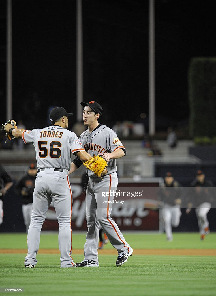Tim Lincecum of the San Francisco Giants is congratulated Andres Torres after pitching a no hitter during a baseball game against the San Diego...