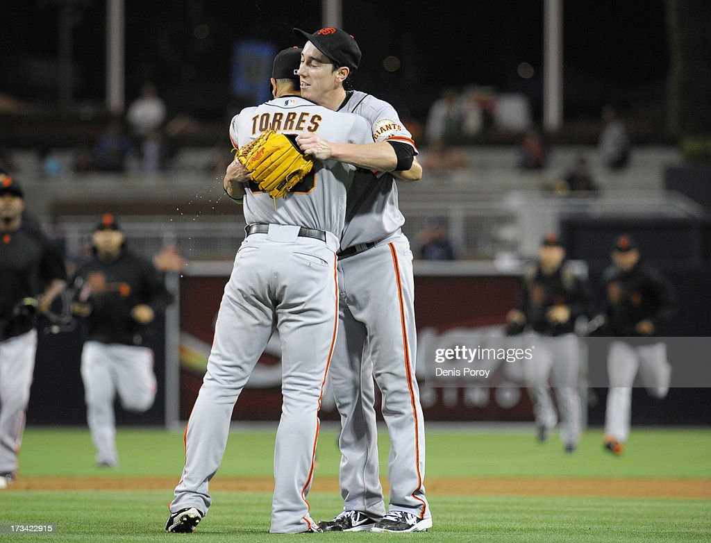 <a gi-track='captionPersonalityLinkClicked' href=/galleries/search?phrase=Tim+Lincecum&family=editorial&specificpeople=4175405 ng-click='$event.stopPropagation()'>Tim Lincecum</a> #55 of the San Francisco Giants is hugged by <a gi-track='captionPersonalityLinkClicked' href=/galleries/search?phrase=Andres+Torres&family=editorial&specificpeople=835839 ng-click='$event.stopPropagation()'>Andres Torres</a> #56 after he pitched a no-hitter during a baseball game against the San Diego Padres at Petco Park on July 13, 2013 in San Diego, California.