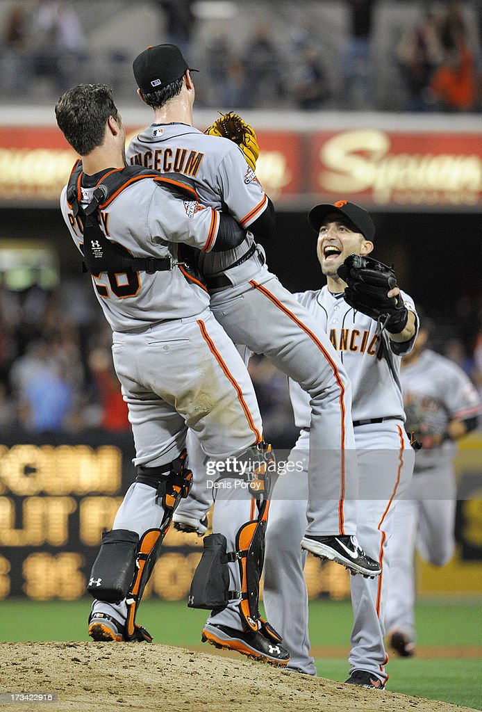 <a gi-track='captionPersonalityLinkClicked' href=/galleries/search?phrase=Tim+Lincecum&family=editorial&specificpeople=4175405 ng-click='$event.stopPropagation()'>Tim Lincecum</a> #55 of the San Francisco Giants is lifted by <a gi-track='captionPersonalityLinkClicked' href=/galleries/search?phrase=Buster+Posey&family=editorial&specificpeople=4896435 ng-click='$event.stopPropagation()'>Buster Posey</a> #28 after pitching a no-hitter during a baseball game against the San Diego Padres at Petco Park on July 13, 2013 in San Diego, California.