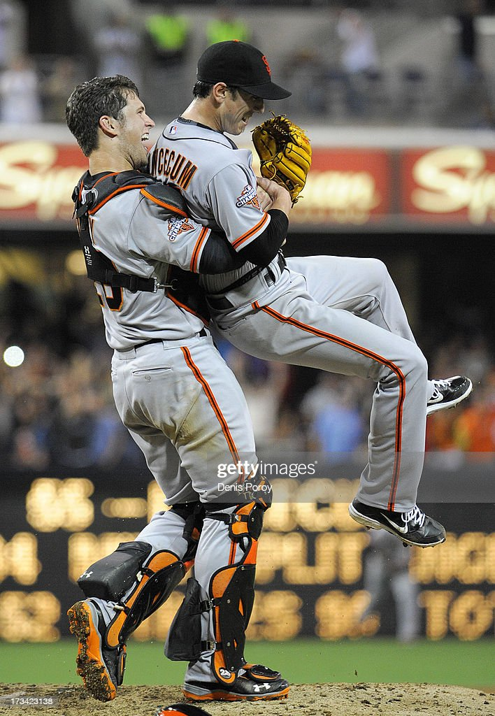 <a gi-track='captionPersonalityLinkClicked' href=/galleries/search?phrase=Tim+Lincecum&family=editorial&specificpeople=4175405 ng-click='$event.stopPropagation()'>Tim Lincecum</a> #55 of the San Francisco Giants is lifted by <a gi-track='captionPersonalityLinkClicked' href=/galleries/search?phrase=Buster+Posey&family=editorial&specificpeople=4896435 ng-click='$event.stopPropagation()'>Buster Posey</a> #28 after pitching a no hitter during a baseball game against the San Diego Padres at Petco Park on July 13, 2013 in San Diego, California.