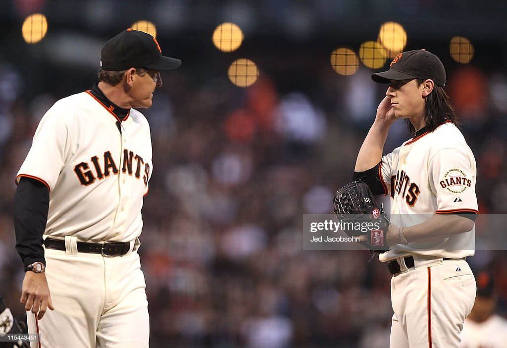 <a gi-track='captionPersonalityLinkClicked' href=/galleries/search?phrase=Tim+Lincecum&family=editorial&specificpeople=4175405 ng-click='$event.stopPropagation()'>Tim Lincecum</a> #55 of the San Francisco Giants looks on with pitching coach <a gi-track='captionPersonalityLinkClicked' href=/galleries/search?phrase=Dave+Righetti&family=editorial&specificpeople=210835 ng-click='$event.stopPropagation()'>Dave Righetti</a> after giving up three runs in the third inning against the Washington Nationals during an MLB game at AT&T Park on June 6, 2011 in San Francisco, California.