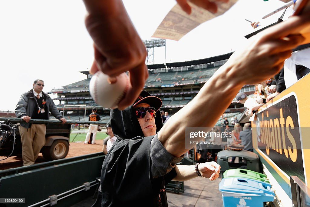<a gi-track='captionPersonalityLinkClicked' href=/galleries/search?phrase=Tim+Lincecum&family=editorial&specificpeople=4175405 ng-click='$event.stopPropagation()'>Tim Lincecum</a> #55 of the San Francisco Giants signs autographs before their home game against the St. Louis Cardinals at AT&T Park on April 5, 2013 in San Francisco, California.