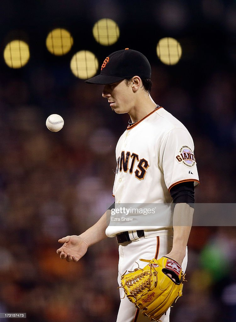 Tim Lincecum #55 of the San Francisco Giants tosses the ball into the air during the sixth inning, in which he gave up two runs to the New York Mets at AT&T Park on July 8, 2013 in San Francisco, California.