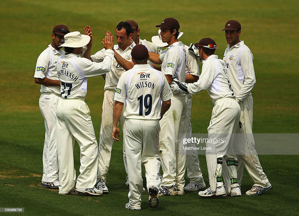 Tim Linley of Surrey is congratulated on the wicket of Stephen Peters of Northamptonshire, after he was caught by Chris Schofield during the LV County Championship match between Northamptonshire and Surrey at the County Ground on May 24, 2010 in Northampton, England.