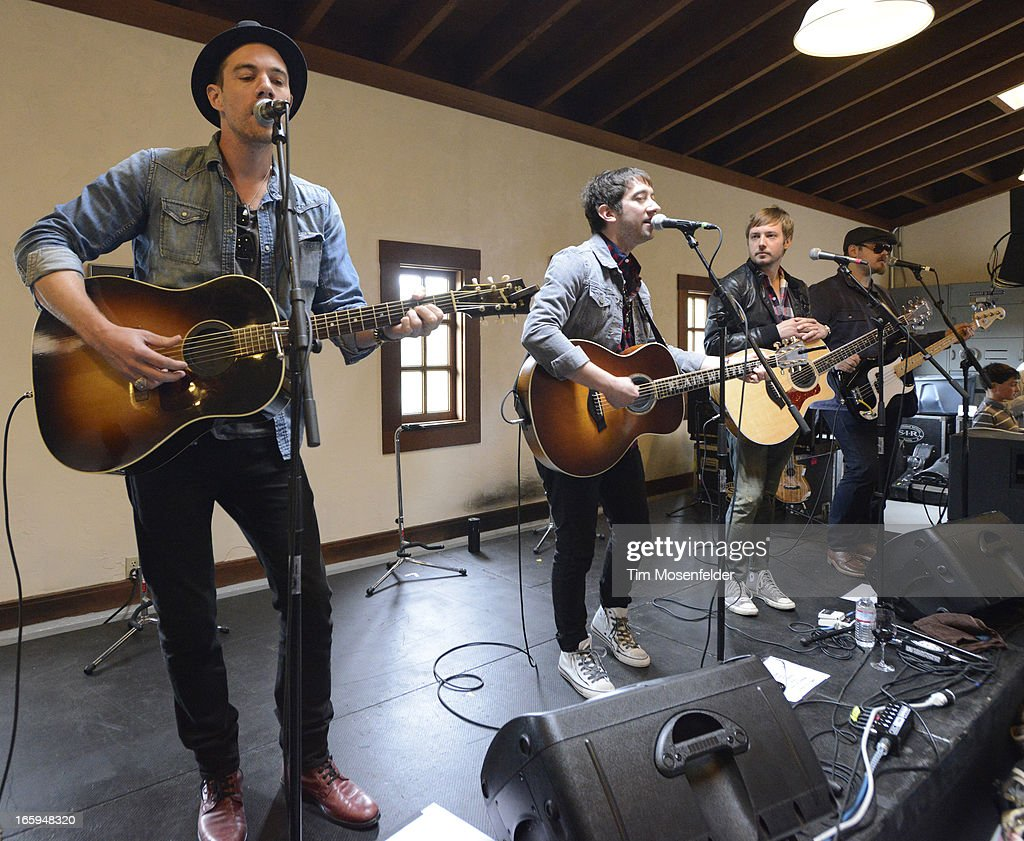 Tim Lopez (L) and Tom Higgenson (C) of the Plain White T's perform at Far Niente Winery as part of Live In The Vineyard on April 6, 2013 in Napa, California.
