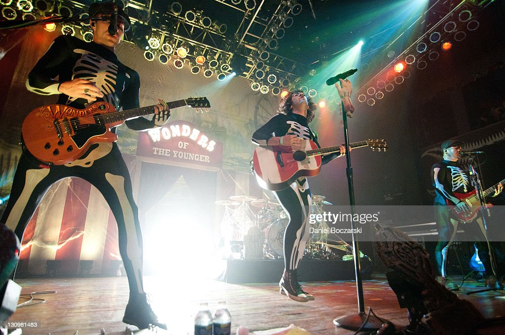 Tim Lopez, Tom Higgenson and Mike Retondo of Plain White T's perform on stage at House Of Blues Chicago on October 30, 2011 in Chicago, Illinois.