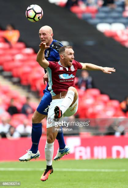 Tim Lowe of Cleethorpes Town rises above David Foley of South Shields to head the ball during The Buildbase FA Vase Final between South Shields and...