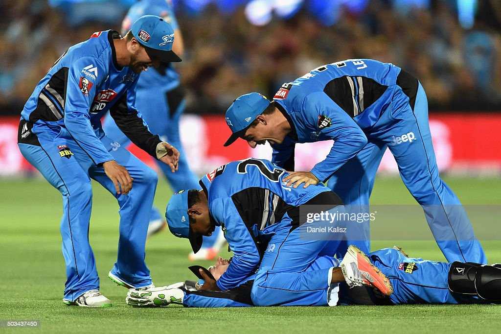 Tim Ludeman of the Adelaide Strikers and Mahela Jayawardena of the Strikers react after taking a catch to dismiss Shaun Marsh of the Scorchers during the Big Bash League match between the Adelaide Strikers and Perth Scorchers at Adelaide Oval on January 5, 2016 in Adelaide, Australia.