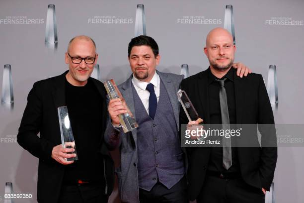 Tim Maelzer and members of the 'Kitchen Impossible' team pose with their awards at the German Television Award at Rheinterrasse on February 2 2017 in...