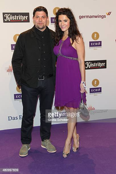 Tim Maelzer Mariella Ahrens pose on the red carpet prior the Echo award 2014 at Messe Berlin on March 27 2014 in Berlin Germany