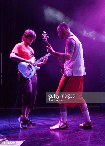 Tim Mahoney and PNut of 311 perform at the DTE Energy Center on July 7 2010 in Clarkston Michigan