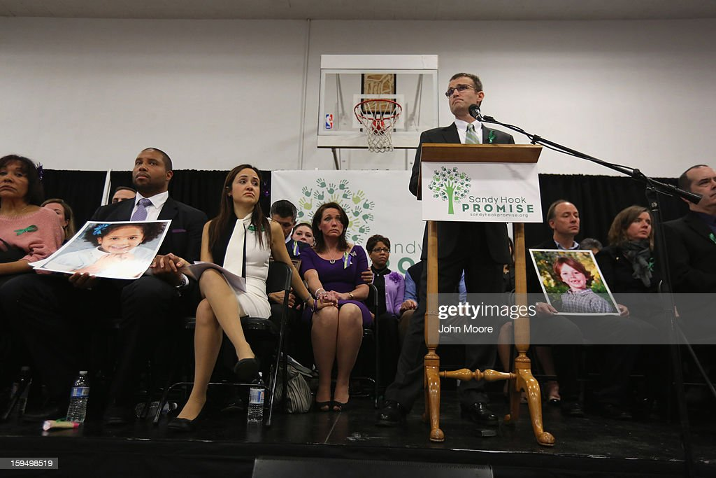 Tim Makris speaks with parents of Sandy Hook Elementary School massacre victims during a press conference on the one month anniversary of the Newtown elementary school massacre on January 14, 2013 in Newtown, Connecticut. Eleven families of Sandy Hook massacre victims came to the event one month after the shooting to give their support to Sandy Hook Promise, a new non-profit with the goal of preventing such tragedies in the future.