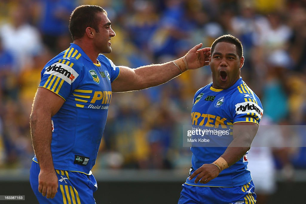 Tim Mannah of the Eels congratulates with <a gi-track='captionPersonalityLinkClicked' href=/galleries/search?phrase=Chris+Sandow&family=editorial&specificpeople=5378003 ng-click='$event.stopPropagation()'>Chris Sandow</a> of the Eels as he celebrates after scoring a try during the round one NRL match between the Parramatta Eels and the Warriors at Parramatta Stadium on March 9, 2013 in Sydney, Australia.